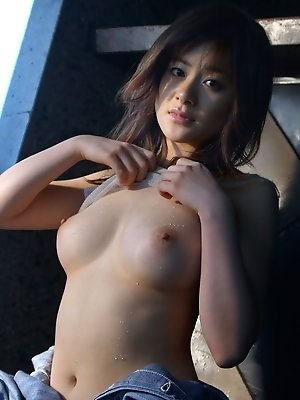 Lovely Asian model takes off her bottoms to show off her nice round ass