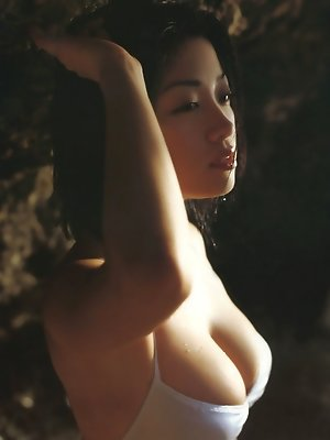 Short haired asian model with soft subtle breasts in a bikini