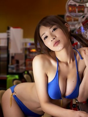 Sizzling asian hottie plays the slots in her purple bikini