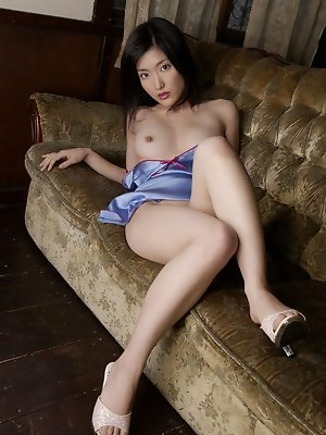 Enchanting Rei Amami takes off her red dress and gets naked